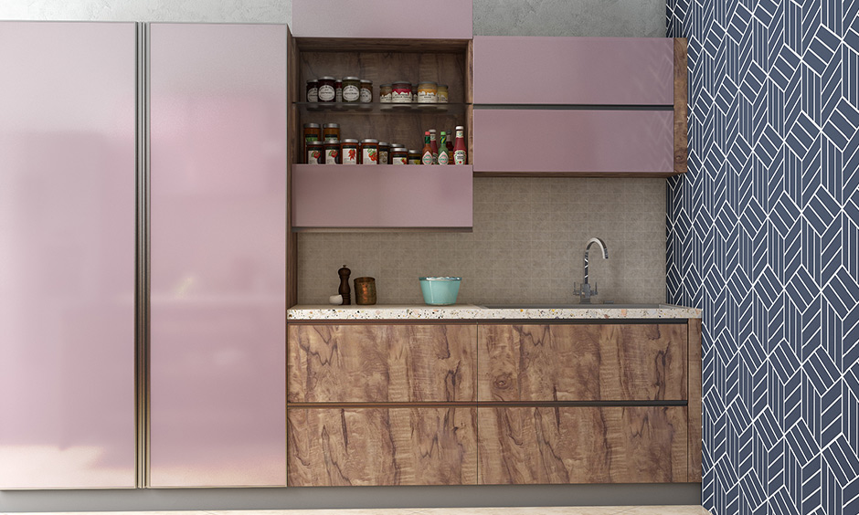This pink bi-fold split shutter wall kitchen unit splits in the middle and opens vertically revealing deep storage
