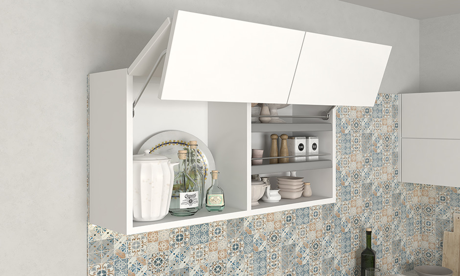 This white bifold lift-up shutter wall kitchen unit is a two-piece shutter that folds at the center and lifts up vertically.