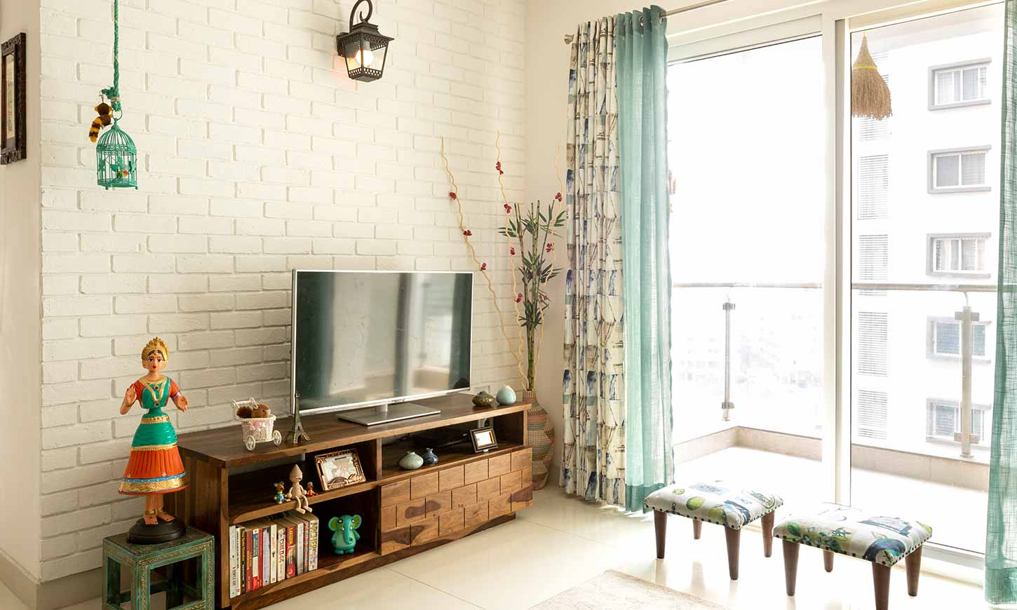 Living room interior wih small tv unit designed by affordable interior designers in bangalore