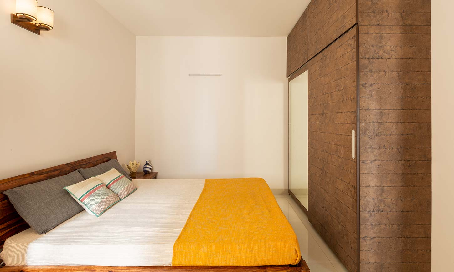Bedroom interior with wardrobe and loft designed by best interior design firms in bangalore