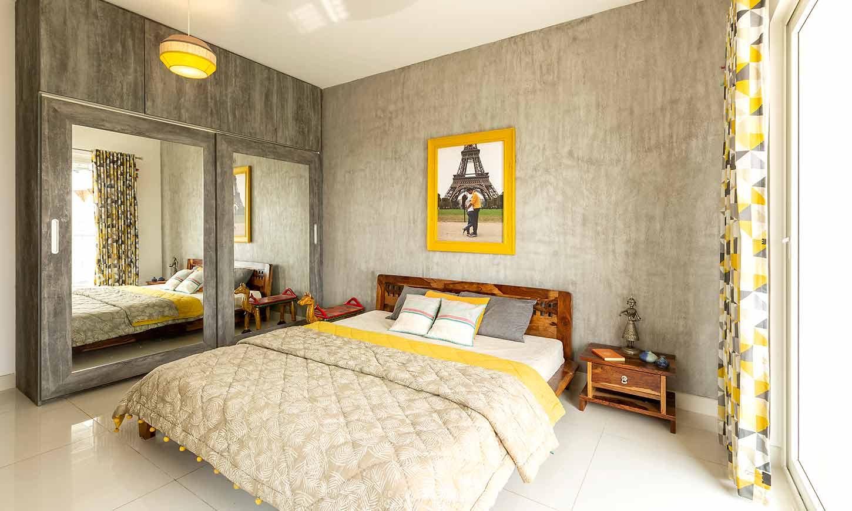 Bedroom designed with big glass wardrobe for interior design services in bangalore