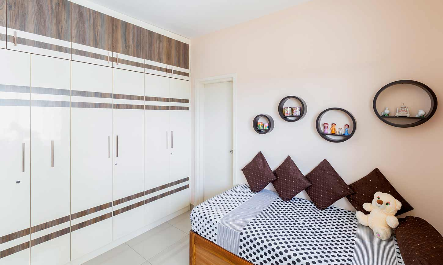 Bedroom with diwan and wardrobe designed by budget interiors bangalore