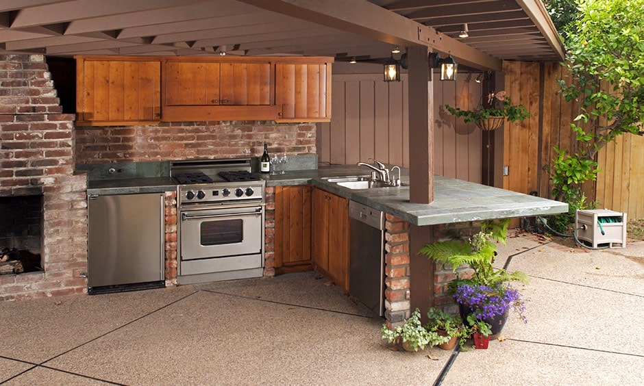 Outdoor kitchen idea with an outdoor brick kitchen with a pool makes a summer's day