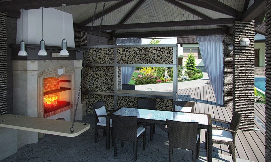 Charcoal outdoor kitchen with outdoor furniture in a relaxing patio