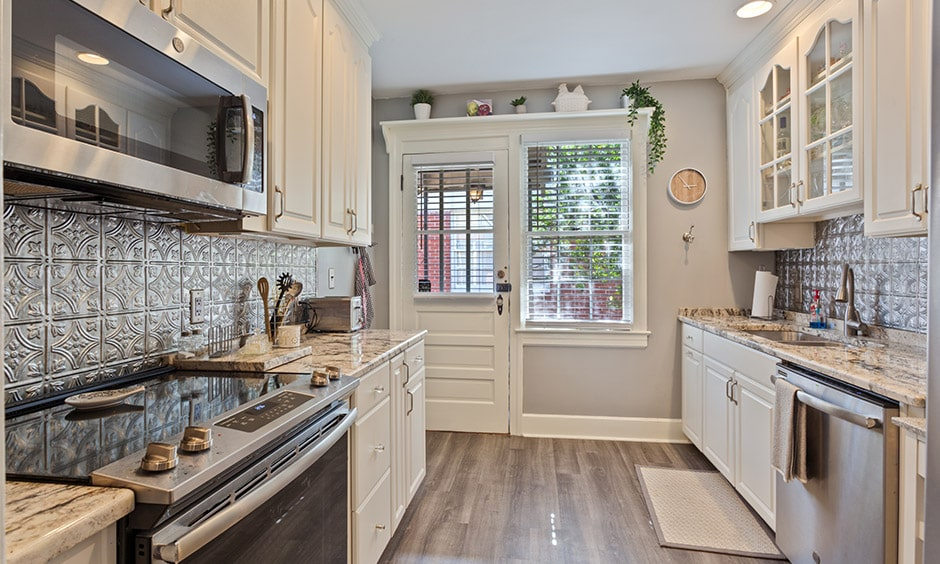 Galley kitchen layout with a whitewood kitchen with a hint of english touch