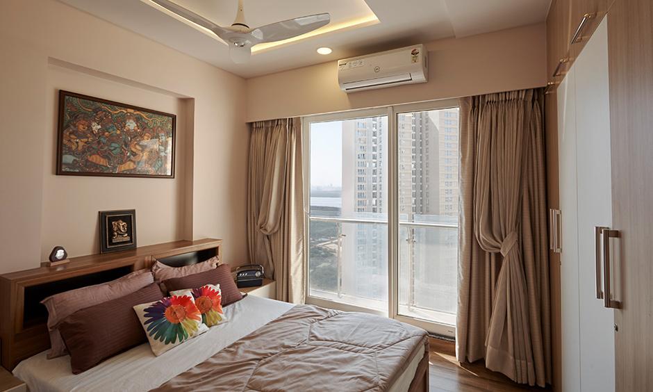 Bedroom with wardrobe designed by luxury interior designers in mumbai