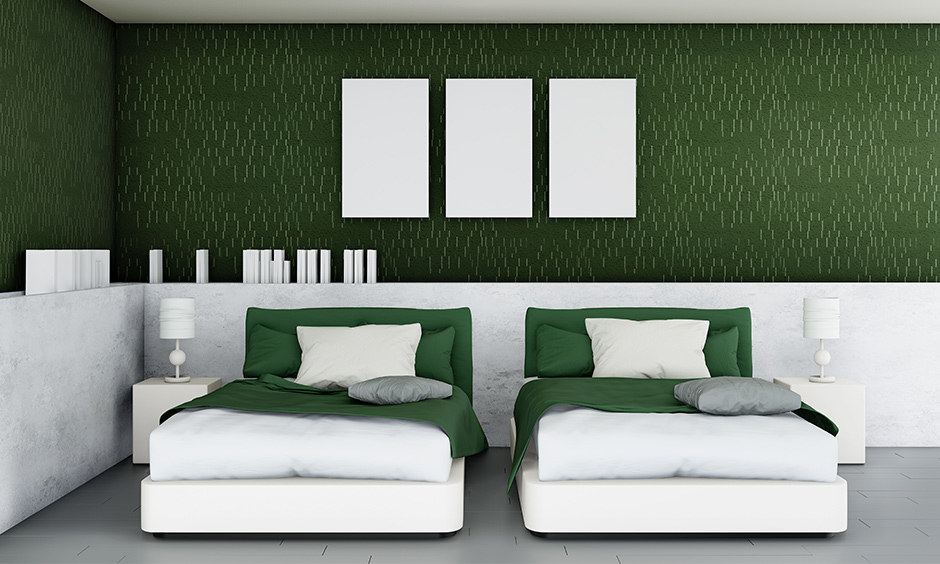 A twin bedroom in green with beautiful bold yet dark shade you will never want to leave