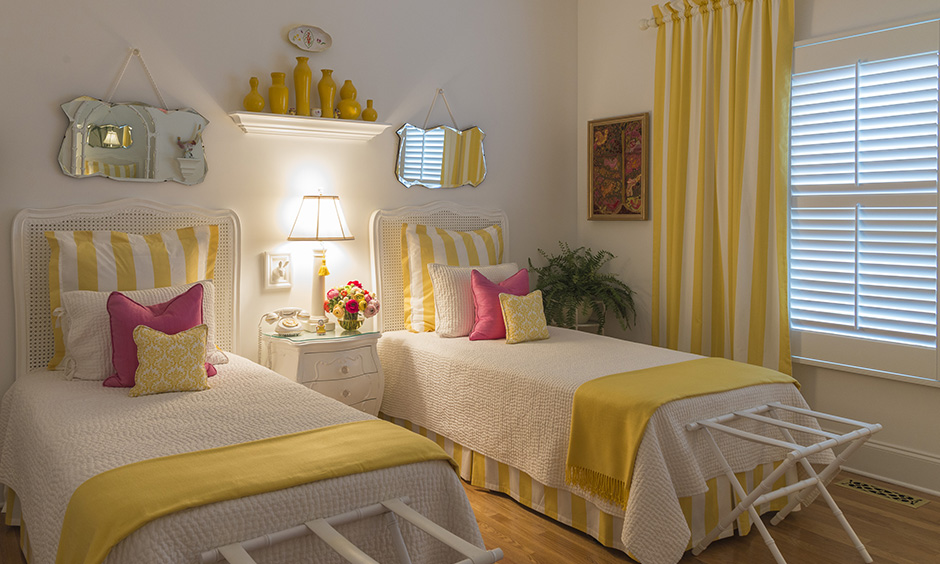 Yellow twin bedroom sets for adults with twin clothing racks in a mini size to hang towels