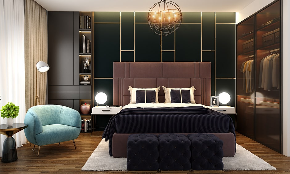 Stylish bedroom designs for couples with a blue armchair and set of dark pouffes