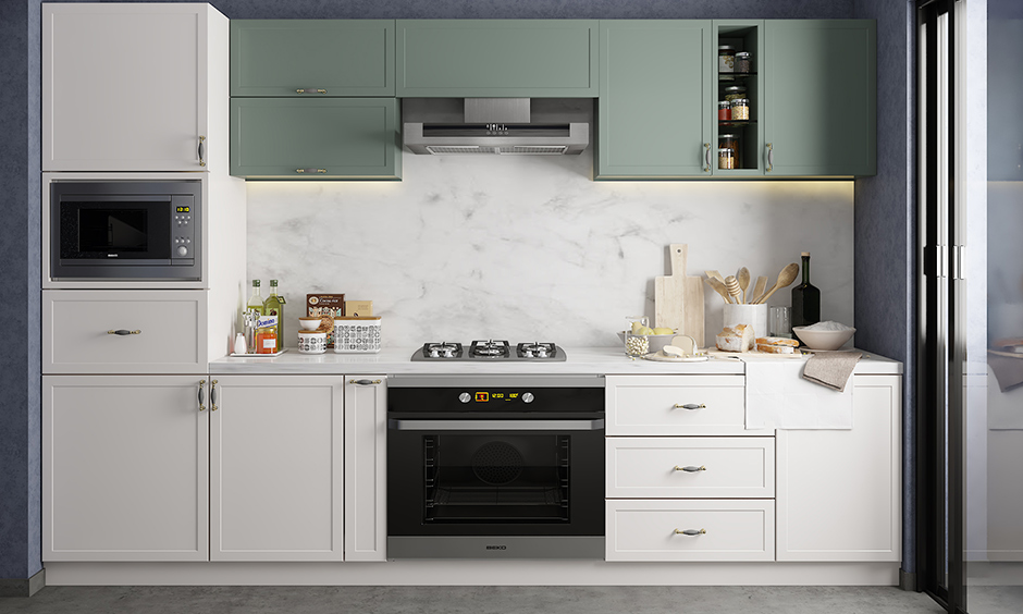 One wall kitchen with white cabinets against splash of grey tinge wall and marble backsplash look elegant