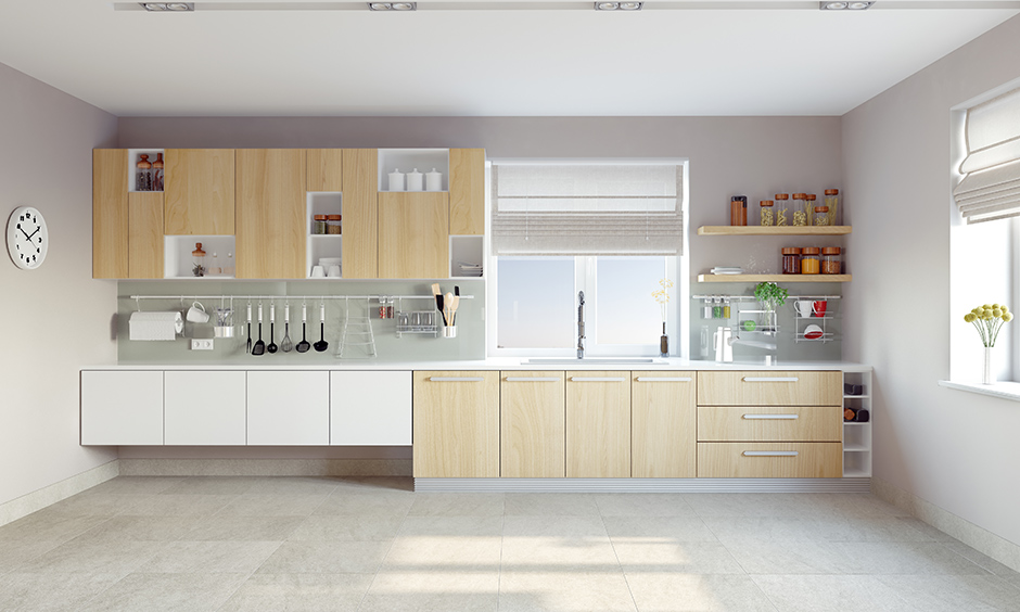 White single wall kitchen layout with a variety of cabinets, drawers, shelves and railing looks clutter-free.