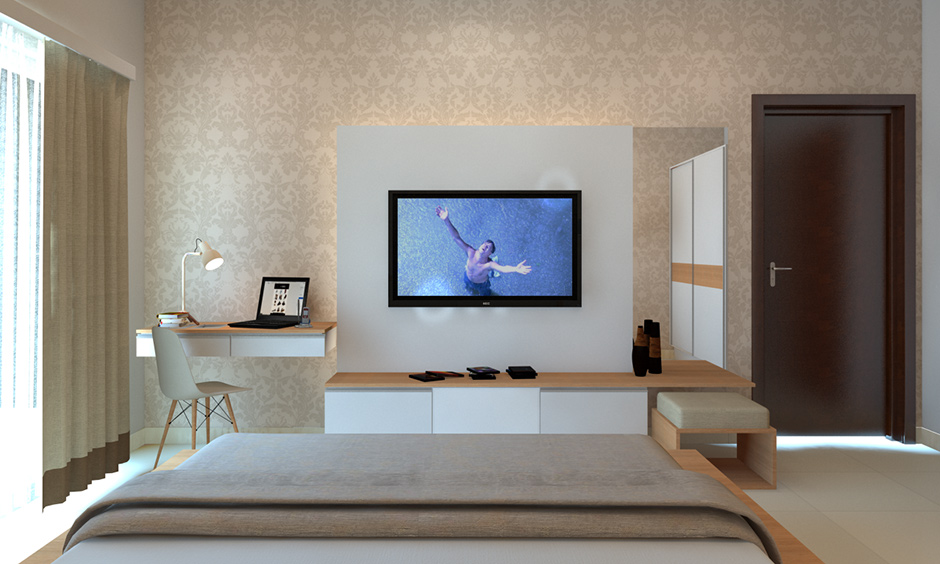 Tv unit attached to a dresser with inbuilt drawer in modern luxury master bedroom designs is premium.