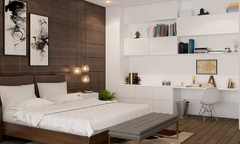 Wooden flooring brings in warmth and elegance in this modern master bedroom with study unit