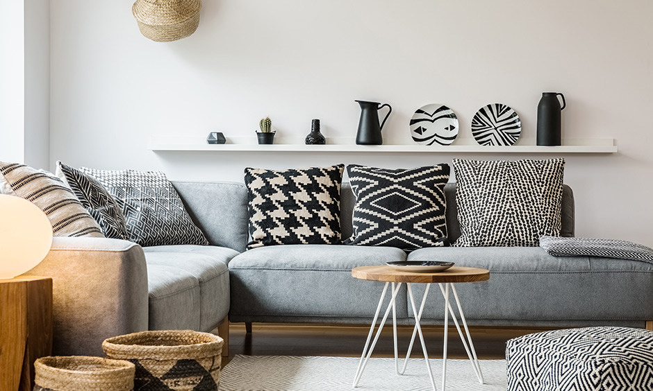 Sofa upholstery ottoman in a jazzy print with matching cushions gives this living room a bit of character.