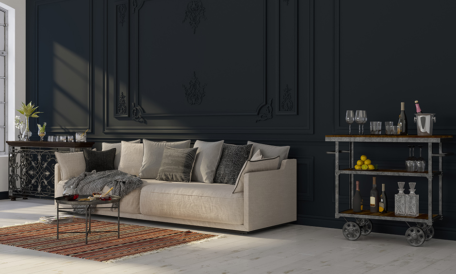 Modern vintage living room with black wall, brown & beige furniture, an old rolling bar cabinet brings charm to this space.