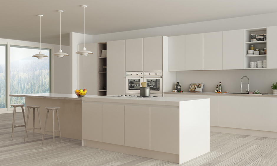 All white marble countertops in kitchen island with lighting and subtle hardwood flooring
