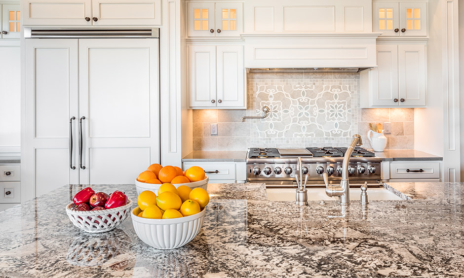 Kitchen design marble countertops with veined marble and superior choice of materials for the flooring and backsplashes