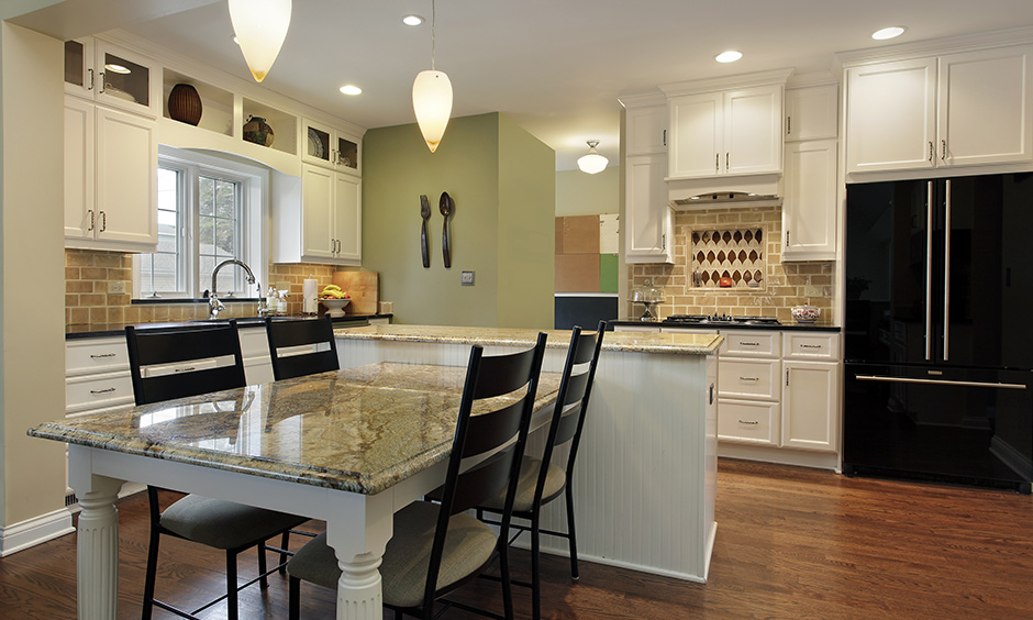 Neutral granite dining table designs which  can seamlessly warm up your kitchen/dining area