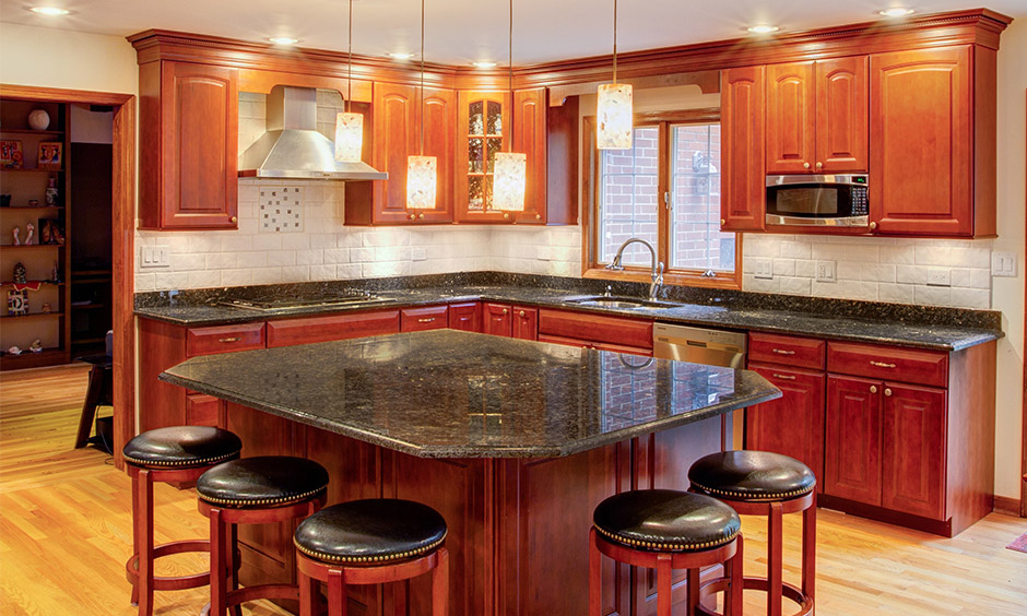 Granite top dining table and chairs with stools that can seamlessly warm up your kitchen/dining area