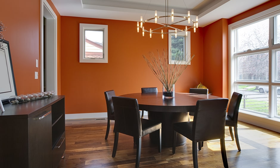 Dining room wall painting with a pop of orange