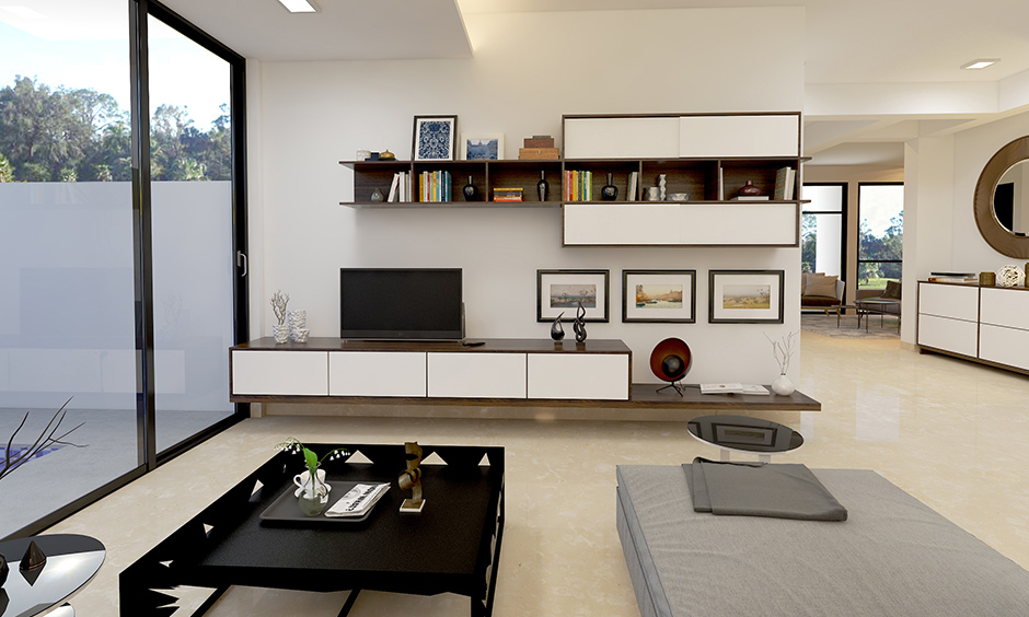 Maximalist home white Tv unit with overhead sliding mirror shelves and pullout drawer are perfect for storage.