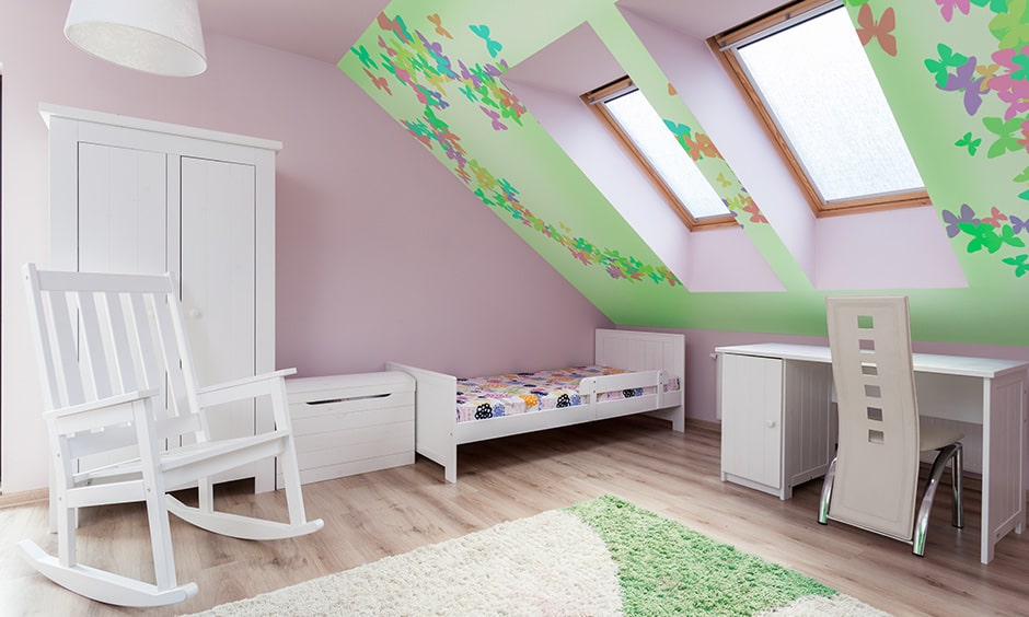 Childrens bedroom design in attic area, wallpaper in attic roof makes this kids bedroom look colourful