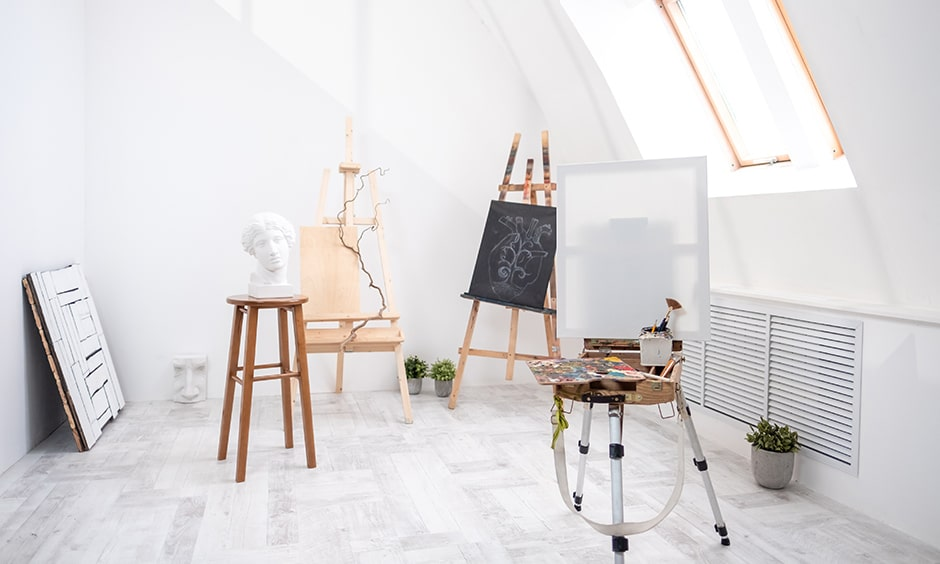 Home art studio design in attic with lots of natural light perfect for art studio