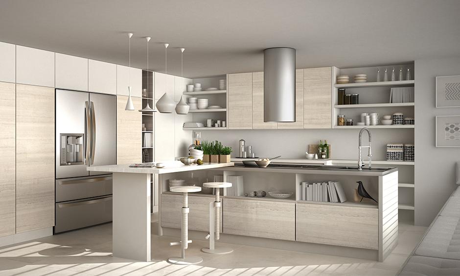 White luxury modular kitchen has fancy drop lights, bookshelf & white adjusting stool to match the marble countertop.
