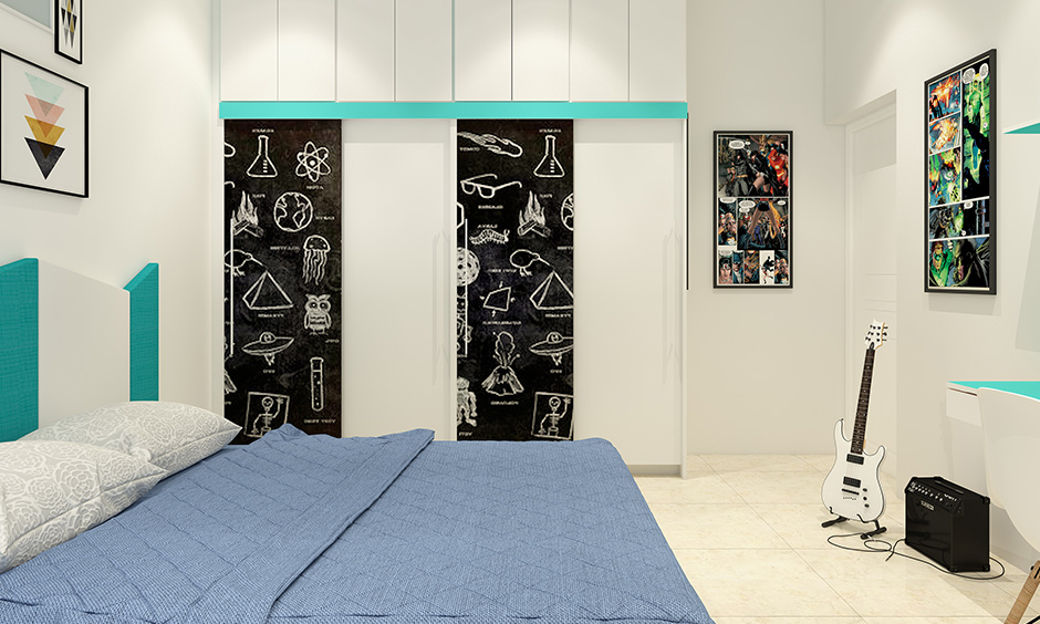 Kids room wardrobe design with multifunctional slate door for doodling & storage for clothes is a fun vibe.