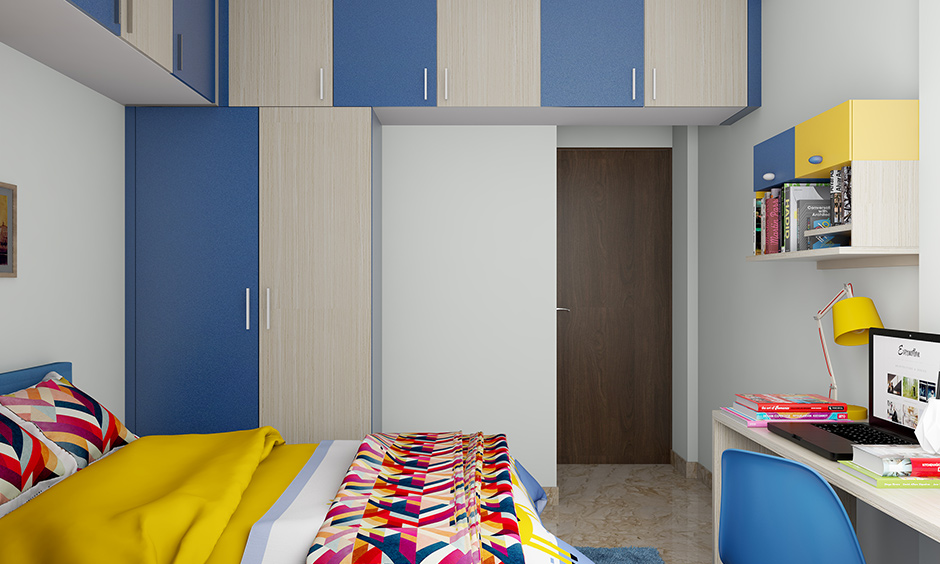 Colorful kids wardrobe designs with a vibrant combination of blue & white with the overhead cabinet are gorgeous.