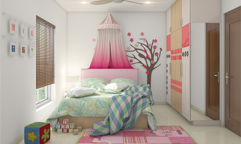 Kids wardrobe design with fresh colours like vibrant pink, dark beige and white look beautiful & push to open doors.