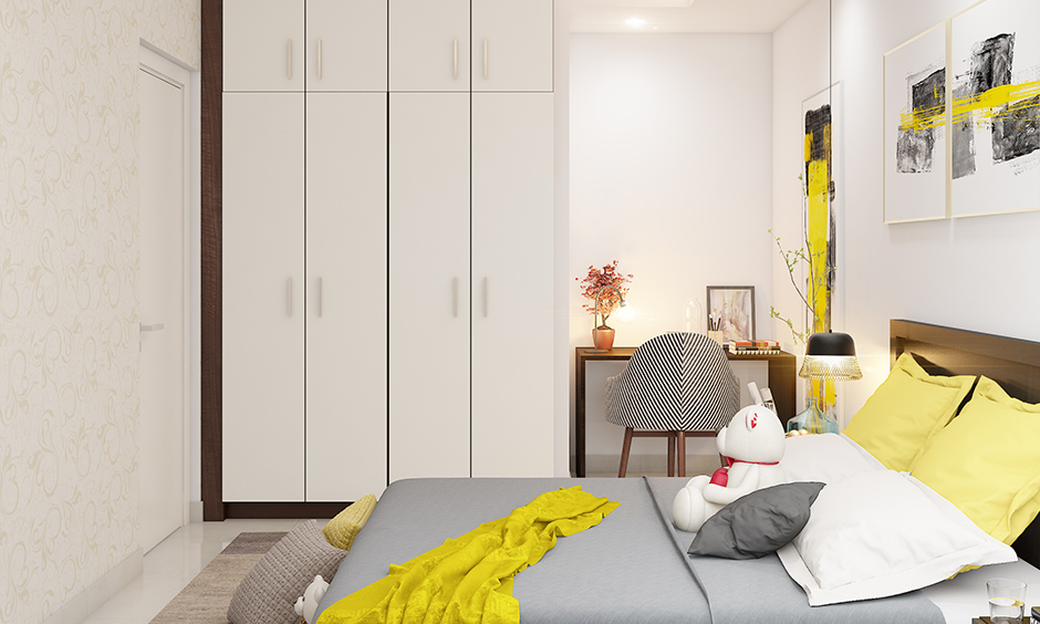 White wardrobe design kids room in a minimalistic style with storage & overhead cabinets looks elegant.