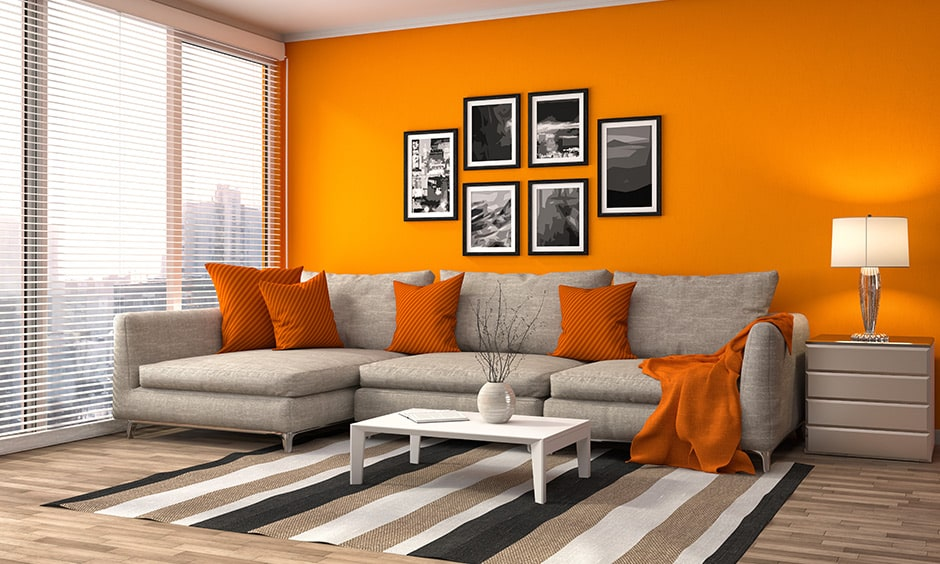 Warm color scheme with a bold orange wall brings in warmth