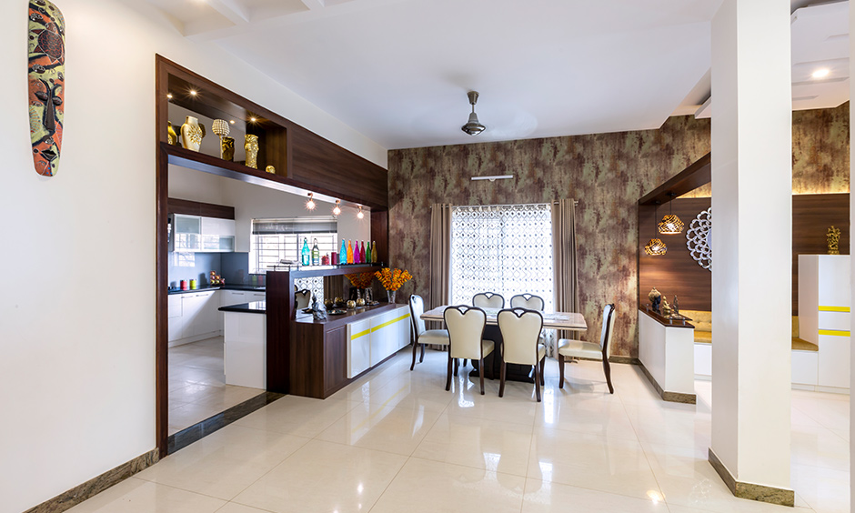 This dining area with a crockery unit that can be accessed looks gorgeous interiors for Rainbow Residency Sarjapur by DC.