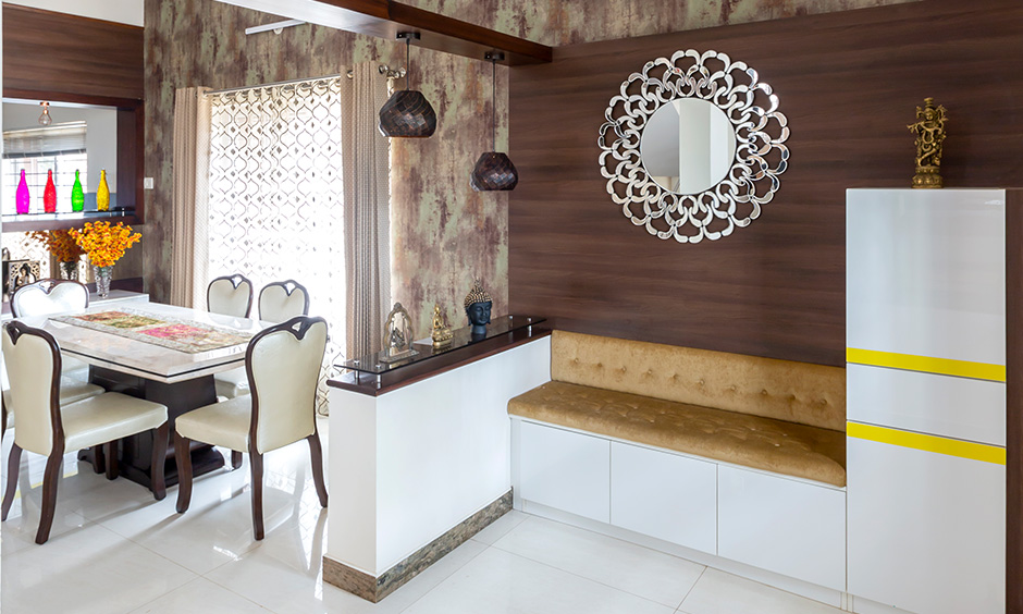 DC top interior designers in Sarjapur Road Bangalore designed this foyer with a shoe rack unit & tufted cushion seating on top.