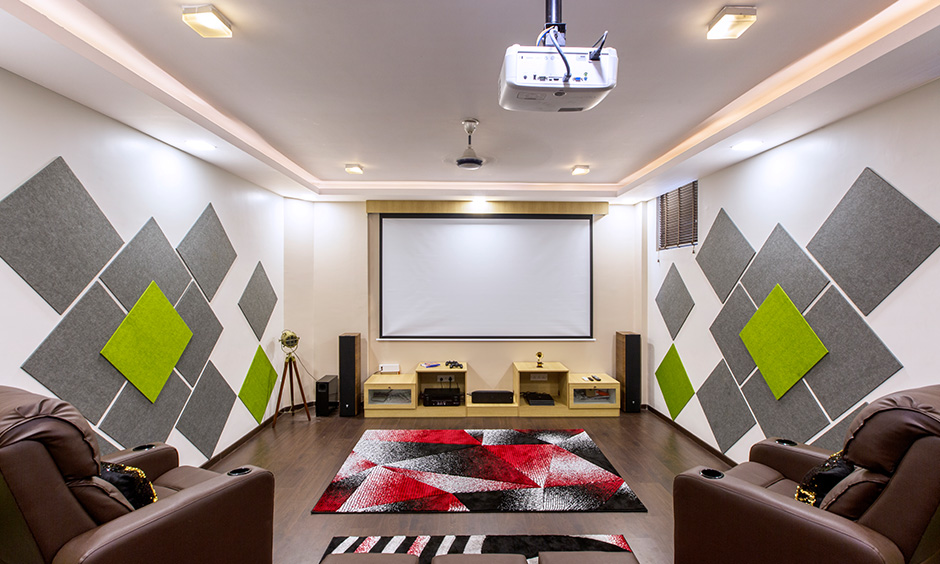 Home theatre interior decorators in Bangalore Sarjapur Road by dc designed with panels & storage brings multiplex like experience.