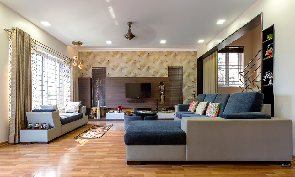 DC interior designers in sarjapur designed this living room with tv unit feel warm, cosy and comforting to all