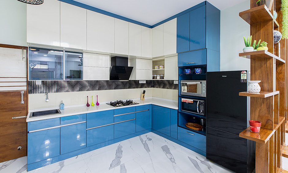Independent house design with a bold kitchen with a bold blue and a frosty white combination