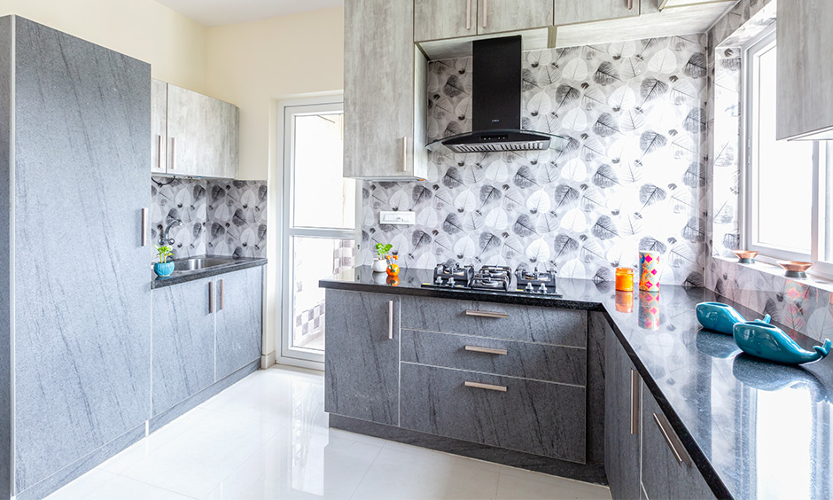 A stoney kitchen designed by top 10 interior designers in bangalore in east parade jain heights by apartments interior designers in bangalore