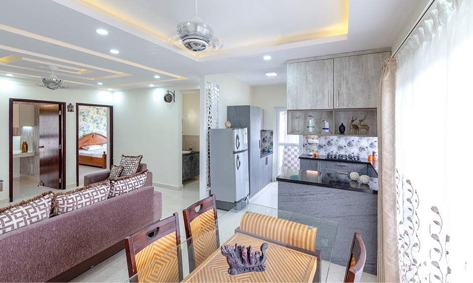 Dining area by apartments interior designers in bangalore  with dining area is also close to the kitchen by residential interior designers in bangalore