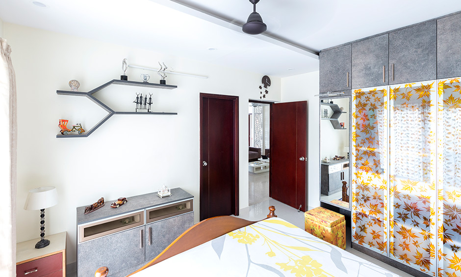Apartments interior designers in bangalore cabinets and shelves have a grey stone finish by interior design in basava nagar