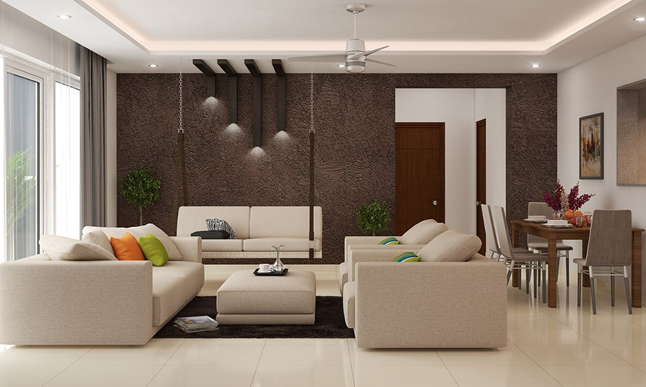 Living room layout with white sofas and an accent wall