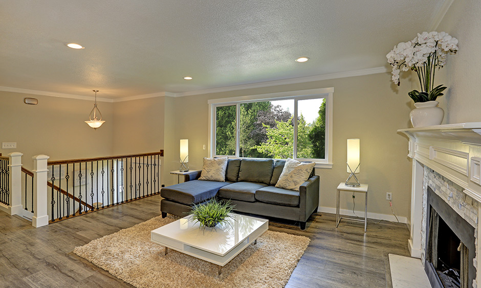 A beige living room wall paint colour with a white ceiling is a simple and elegant look.
