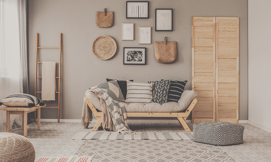 A dark beige & white wall living room colour combination that brings in elegance all with the decor that goes on its wall.