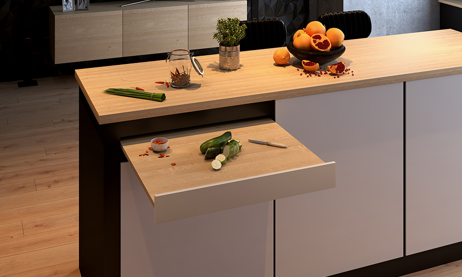 Affordable kitchen island counter design with a chopping board pull-out is a smart way to keep your worktop clean.