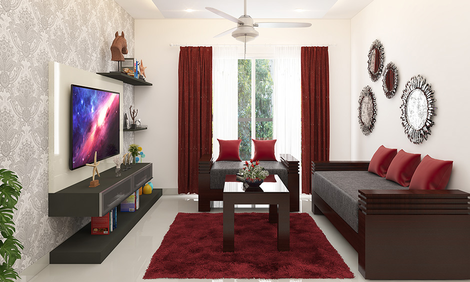 Decorating a small living room with the mirror & artefacts gives a new look.