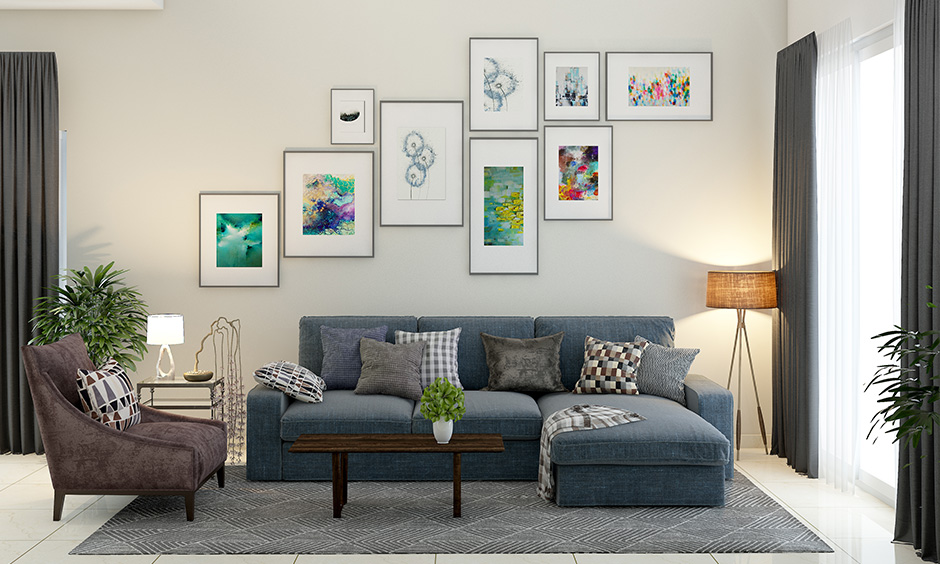 Grey armchair and blue L-shaped sofa are the decorative items for the living room that look beautiful.