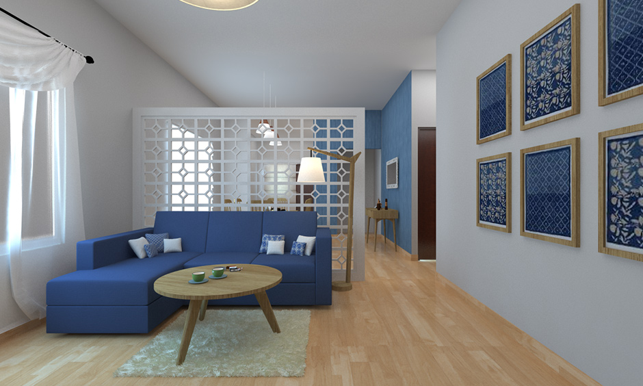 Dining and living room partition with blue sofa and coffee table against the partition feel soothing to the mind, & body.