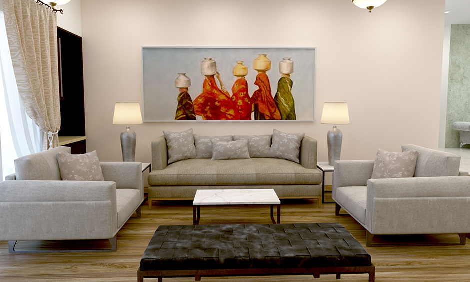 A white living room wall decor with colourful paintings brings soothing effects to the area.