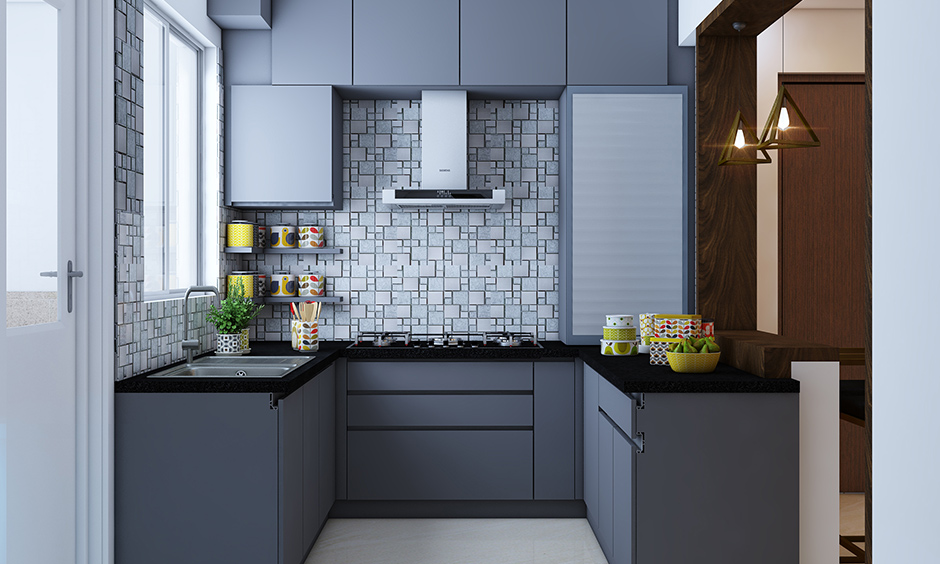 3bhk interior design for a simple fuss free kitchen with tandem drawers, shutter storage